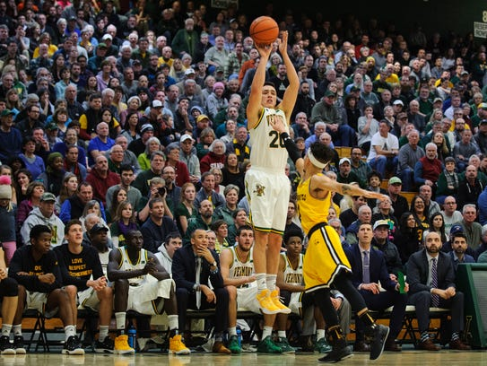Vermont's Ernie Duncan (20) shoots a 3-pointer against the UMBC Retrievers on Saturday, Jan. 6 in Burlington, Vermont.