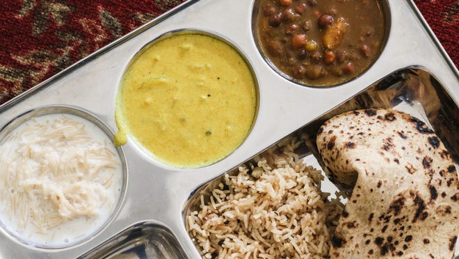 Langar, from left to right; Sevian, a sweet cream dessert, Curry, Chole, a vegetarian stew, with rice and bread is served to all at the Garden State Sikh Association and Gurudwara in Bridgewater .