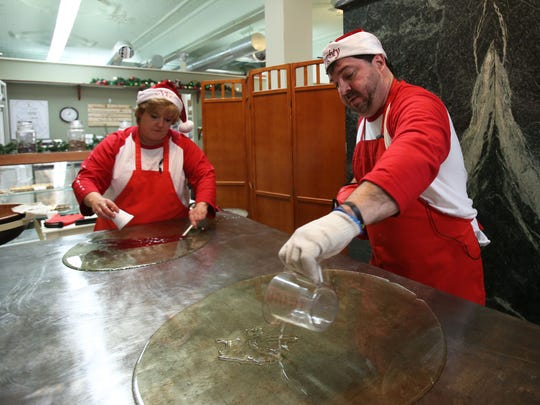 Lucas Candies co-owners Nick Loucas, right, and Debbie