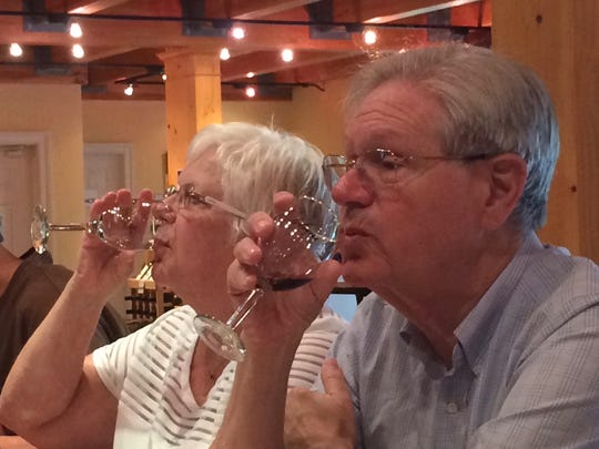 Debbie and Steve Druck sample wines from Bordeleau Winery. The couple, who live in Israel, stopped by during a visit with their family.