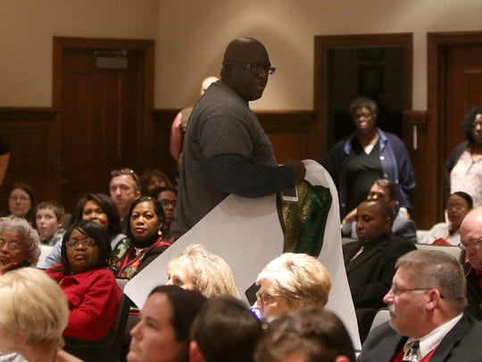 Cory Vann, a member of the Jackson Central-Merry Alumni Association, shouts to the crowd as he leaves the George Smith Room at City Hall on Thursday.