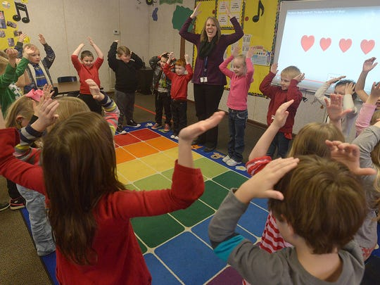 Music teacher Melody Kirkpatrick, center, leads a class of kindergarteners in an exercise on beat at Medina Elementary School on Wednesday. The music classroom is housed in a building separate from the main school.
