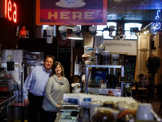 Java Joe's owners Tim and Amy Brehm pose for a portrait at their coffee house on Wednesday, Jan. 27, 2016, in Des Moines. Since 2007 Java Joe's has been hosting candidates and TV shows as they make their way through Iowa during the caucus cycle.