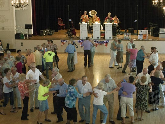 Couples perform the circle two-step on the maple dance floor at Turner Hall, Monroe.