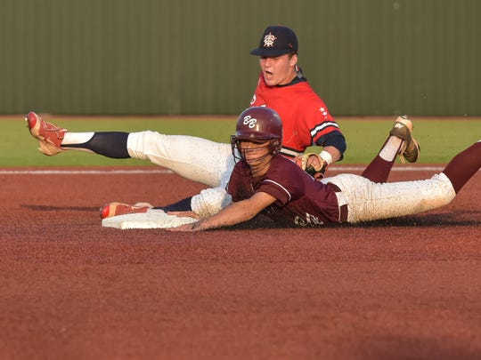 Hayden Cantrell tags out the runner at second base
