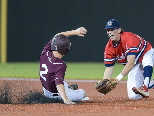 Shortstop Josh Taylor turns the double play as The Teurlings Rebels take on the Breaux Bridge Tigers in State playoff baseball action in Sulphur, LA. May 12, 2016.