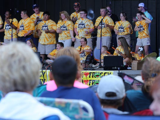 """Students from Camp Imaginarium perform """"Rocky Top"""" with country music artists during the fourth annual Country Music Lends Down a Hand concert at the Casey Jones Village Amphitheatre on Wednesday, June 22, 2016."""