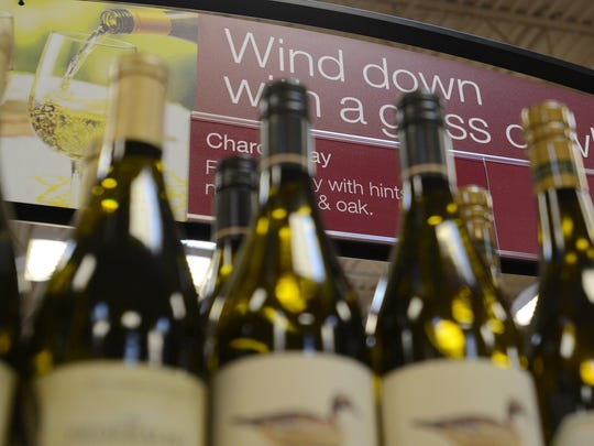 Wine is seen on the shelves at the Kroger on University Parkway, on the first day of sales, Friday, July 1, 2016.