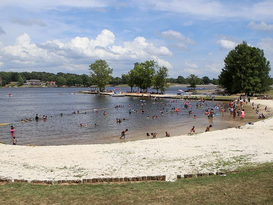 People enjoy the water at Beech Lake during the Festival