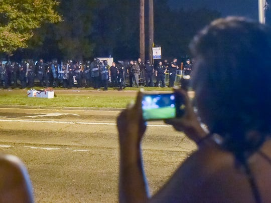 Protester uses phone to record Police activity at the corner of Goodwood and Airline hwy. July 9, 2016.