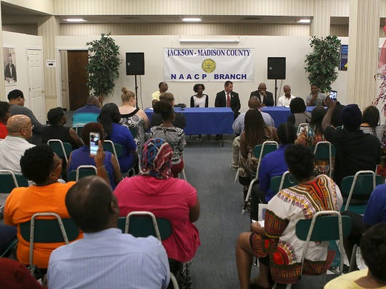 People attend a community meeting at the NAACP office downtown to discuss justice reform on Monday, July 11, 2016.