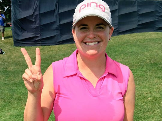 Jackie Stoelting, a Vero Beach High School graduate and Fort Pierce resident, celebrates after winning the Four Winds Invitational in South Bend, Indiana. She also won the previous Symetra Tour event, the Fuccillo Kia Championship on June 6 at Albany, New York.