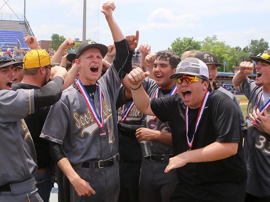 Scotts Hill's Kainan Maners (9), Dylan Montgomery (14), manager Noah Smith and Cole Rogers celebrate their Class A state championship at Middle Tennessee State University's Reese Smith Jr. Field in Murfreesboro, Tenn., on Friday, May 27, 2016.