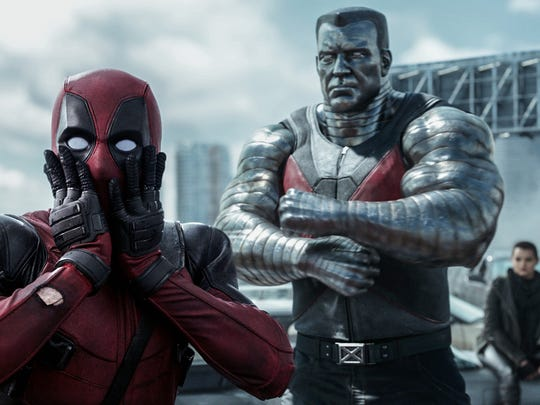 """Ryan Reynolds as Deadpool, from left; Colossus, voiced by Stefan Kapičić; and Brianna Hildebrand as Negasonic Teenage Warhead in a scene from """"Deadpool."""""""