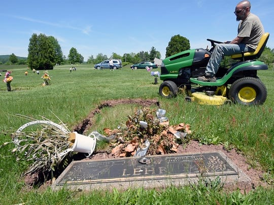In this photo from 2017, Brain Baublitz mowed around a grave that needed attention at Suburban Memorial Gardens in Conewago Township. Baublitz had put out an appeal for mowers after his brother-in-law was upset that the cemetery wasn't mowed.