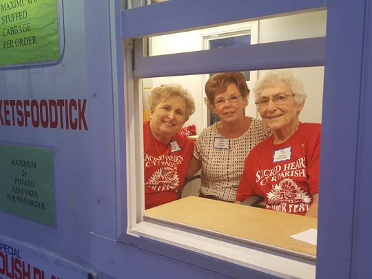 Sacred Heart Church's 50th annual Parish Festival returns July 24 to 28 to Manville. Pictured are three of the more than 150 volunteers who work on the event throughout the year.