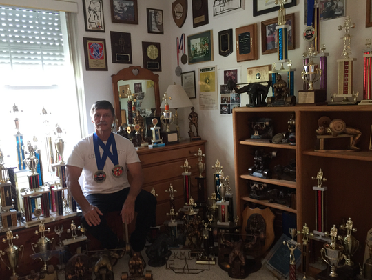 Pensacola's Larry Tilley, 65, at his home with 93 medals,