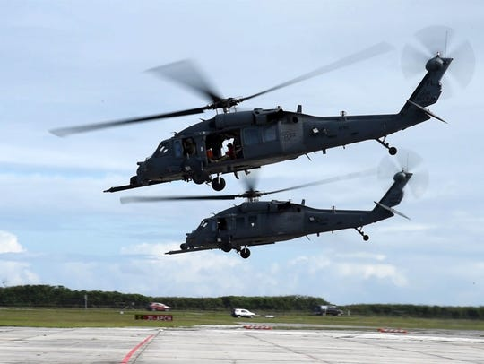 Two Air Force Reserve HH-60 Pave Hawk helicopter crews