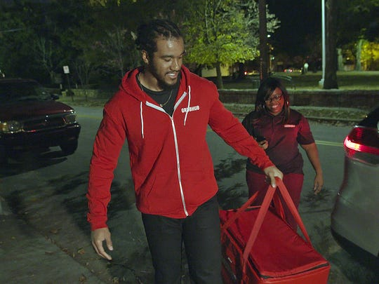 Former Clemson Tiger and current Atlanta Falcons football player Vic Beasley, Jr. made surprise deliveries as a GrubHub driver in Atlanta on Monday, November 27, 2017.