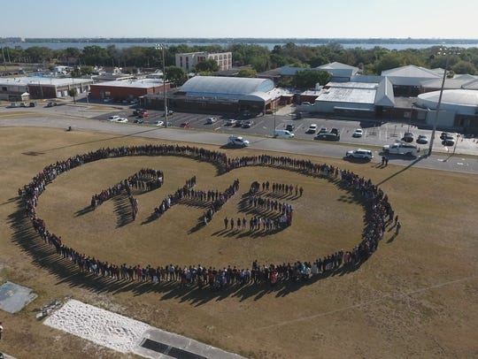 Students formed a heart on the football field during