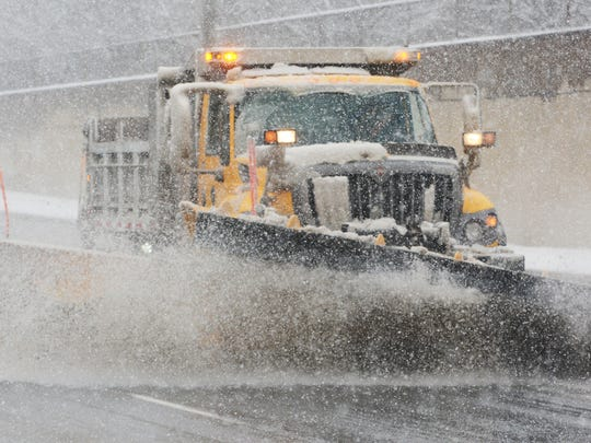 A snow plow clears Richland Avenue during a snow squall