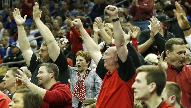 UC fans, shown here cheering during Friday's 66-65 OT win over Purdue, do have some hope against No. 1 UK.