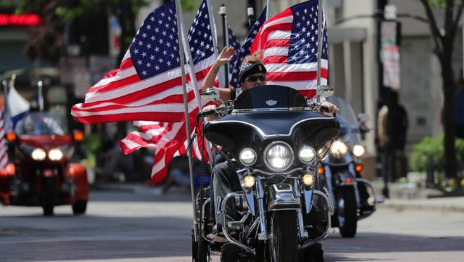 A Harley-Davidson motorcycle is decked out in American flags during Milwaukee's 153rd annual Memorial Day Parade.