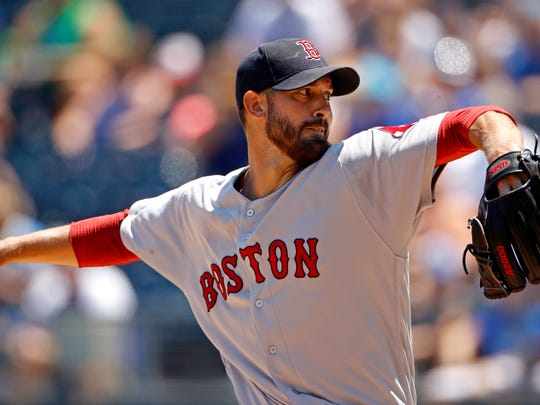 Boston Red Sox starting pitcher Rick Porcello throws during the first inning of a baseball game against the Kansas City Royals, Sunday, July 8, 2018, in Kansas City, Mo. (AP Photo/Charlie Riedel)