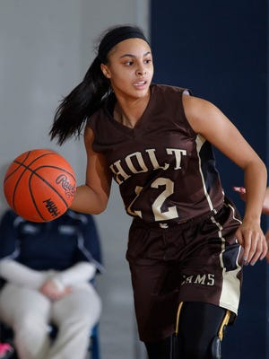 Holt's Kamrin Reed, who is signed with Western Michigan University, recently surpassed 1,000 career points.