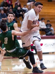 Mt. Whitney's Anthony Valencia drives to the basket against El Diamante's Seth Hall in a West Yosemite League high school boys basketball game on Wednesday, January 3, 2018.
