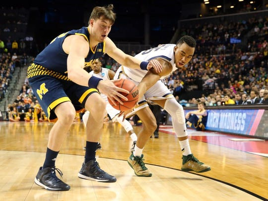 Notre Dame Fighting Irish forward Bonzie Colson (right) battles for the ball with Michigan Wolverines forward Ricky Doyle (left) in the second half in the first round of the 2016 NCAA Tournament at Barclays Center in Brooklyn, N.Y., on March 18, 2016. (Anthony Gruppuso-USA TODAY Sports)