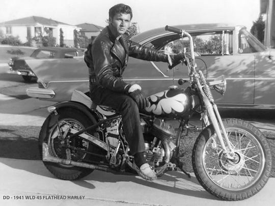 Guitarist Dick Dale astride his 1941 WLD 45 Flathead Harley.