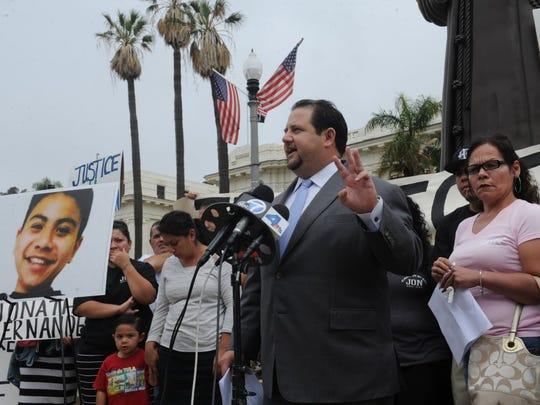 Attorney Sean Andrade, with Joanna Hernandez, right,