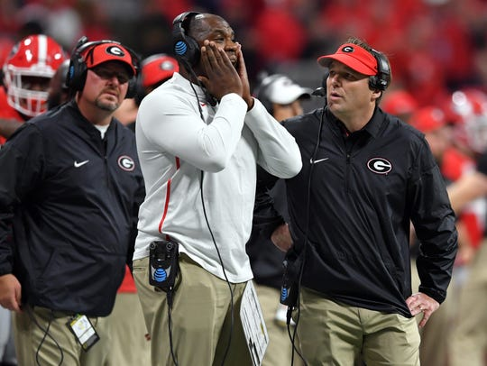 Georgia defensive coordinator Mel Tucker (center, next