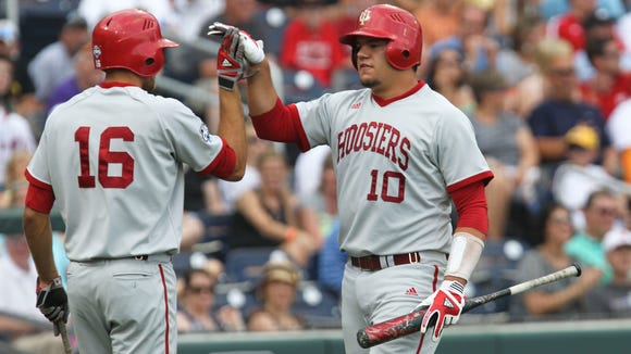Kyle Schwarber (10) and Dustin DeMuth (16) each played a key role in the five-run seventh inning that helped Indiana to a 5-0 win over Michigan in the Big Ten tournament late Thursday.