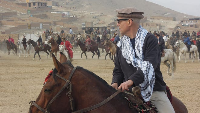 USA TODAY reporter Jim Michaels attends a buzkashi game in Kabul.