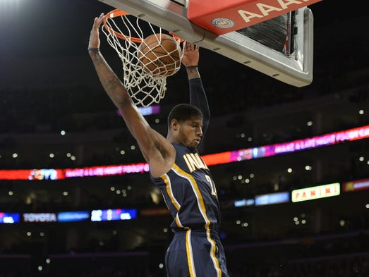 Indiana Pacers small forward Paul George (24) shoots against the Los Angeles Lakers during the second half at Staples Center.