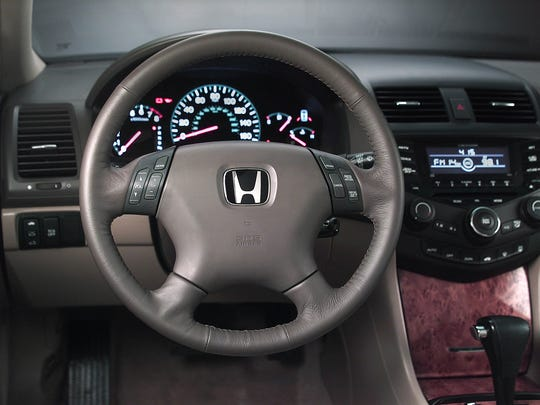 The interior of a 2004 Honda Accord, a model  among