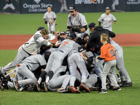 The Oregon State baseball team celebrates after defeating Vanderbilt 9-2 in an NCAA tournament super regional game Saturday, June 10, 2017, in Corvallis, Ore., to advance to the College World Series. (Andy Cripe/The Corvallis Gazette-Times via AP)