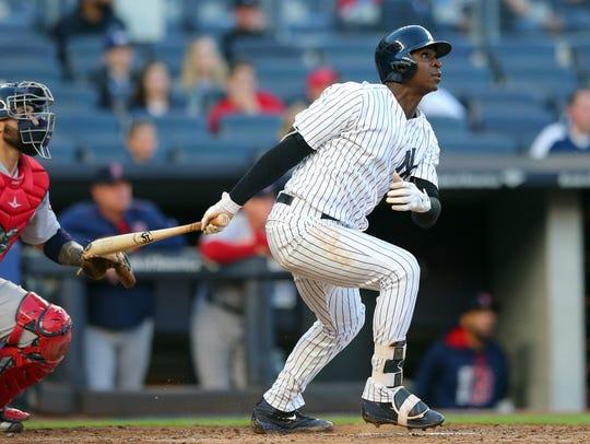 Yankees shortstop Didi Gregorius (18) follows through