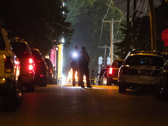 Members of the New Castle County Police and Delaware State Police search Cathedral Drive on a shots fired call Tuesday night.
