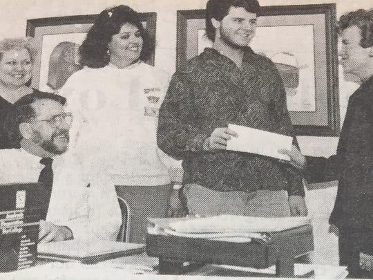 The Professional Women's Club of Morganfield donated $50 to both the Speech and Drama Club and DECA Club at UCHS in March 1988. From left is Women's Club vice-president Jane Pfingston, Richard Vincent, speech and drama members Teresa Shelton and Bruce Coffman, and Women's Club president Nancy Brinkley.
