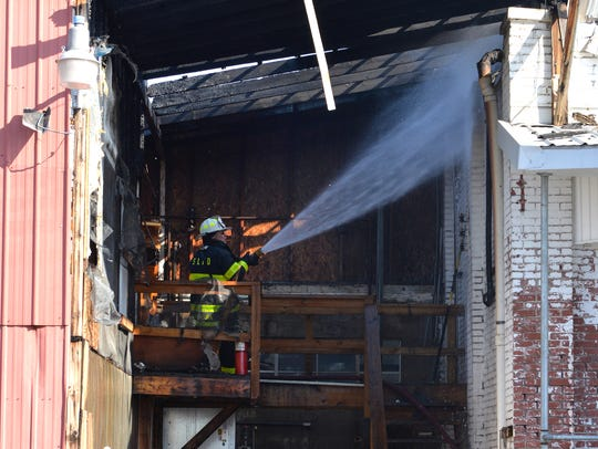 Water is doused on hot spots at the Godshall's Quality