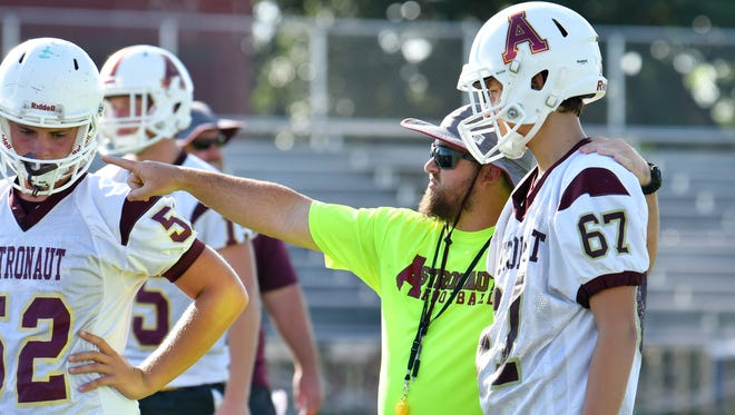 Head Coach Justin Worden. Astronaut High varsity football team's first day of practice for the upcoming season.