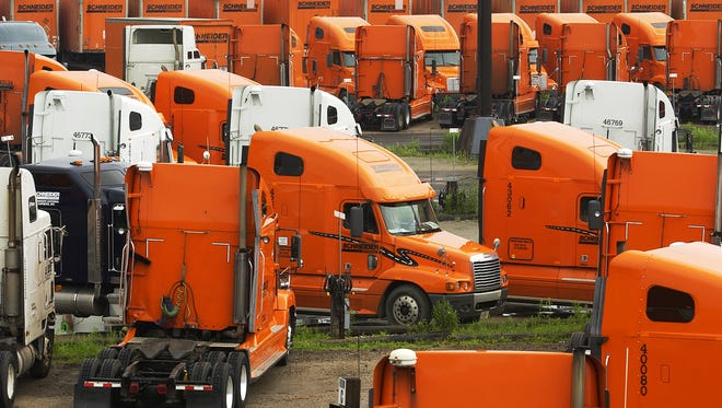 Trucks sit in the yard at Schneider National's South Broadway location in Ashwaubenon.