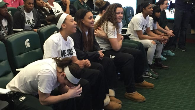 From left, MSU players Tori Jankoska (bowing), Aerial Powers, Kennedy Johnson and Jasmine Hines wait axiously before the NCAA tournament selection show on Monday, March 14, 2016.