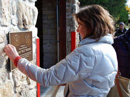 Holly Swain, a physician's assistant with Ministry Door County Medical Center in Fish Creek, takes a moment of reverence in memory of Bill Weborg.
