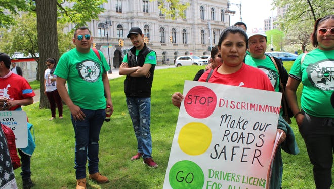 Supporters of a bill, which expands access to driver's licenses to all New York State residents, regardless of immigration status, in Albany.