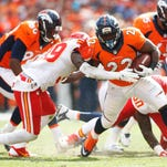 Denver Broncos running back C.J. Anderson (22) runs the ball during the second half against the Kansas City Chiefs at Sports Authority Field at Mile High.