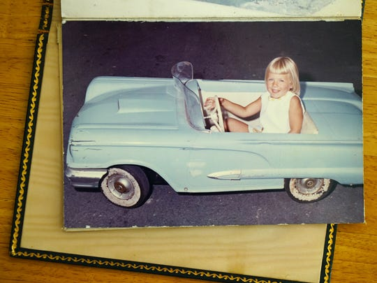 A family photo of Alfred I. duPont's great-granddaughter, Susanna Dent, in a car given to her by her grandmother, Victorine DuPont. Dent returns to Delaware annually for family reunions and stops to marvel at the growth of Nemours/A.I. duPont Hospital for Children in Rockland.